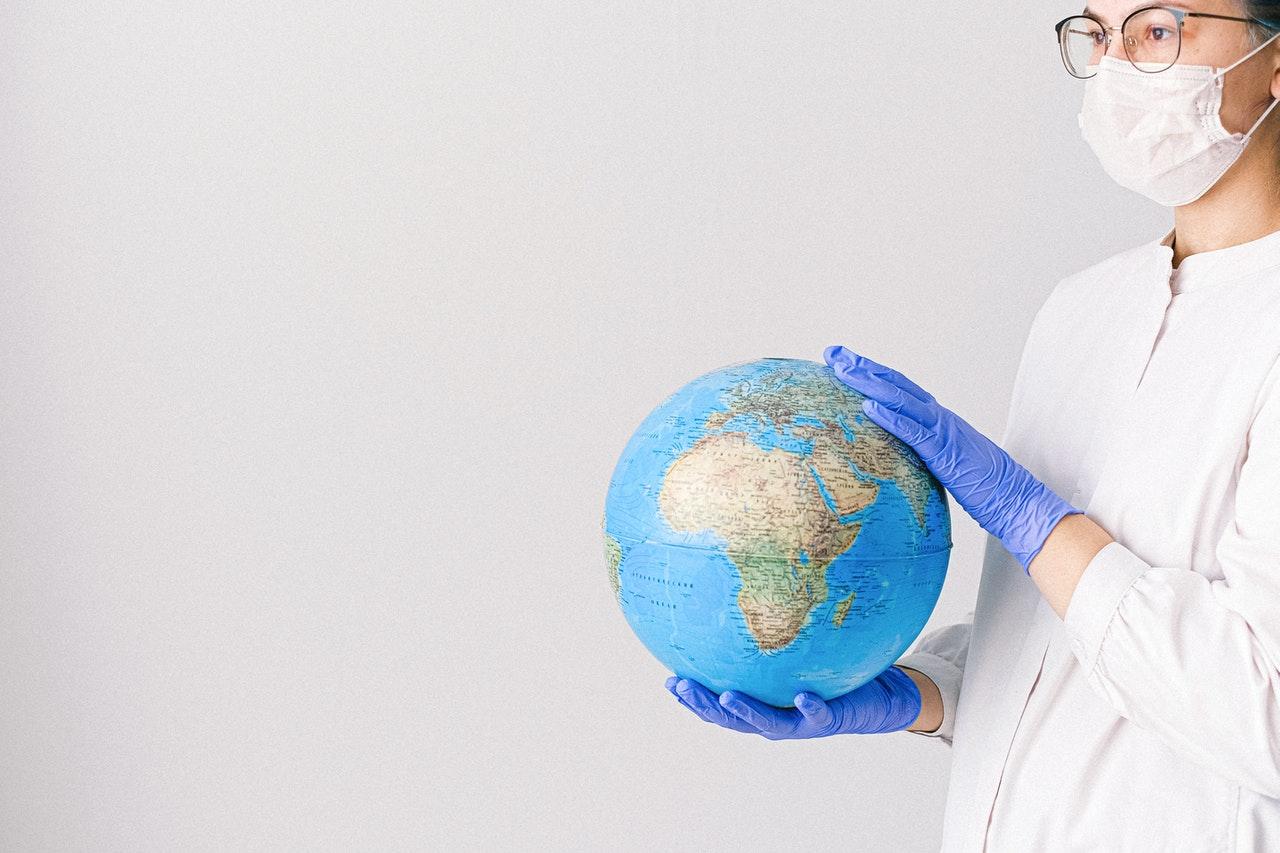Woman in PPE holding a globe - Jean-Francois de Clermont-Tonnerre